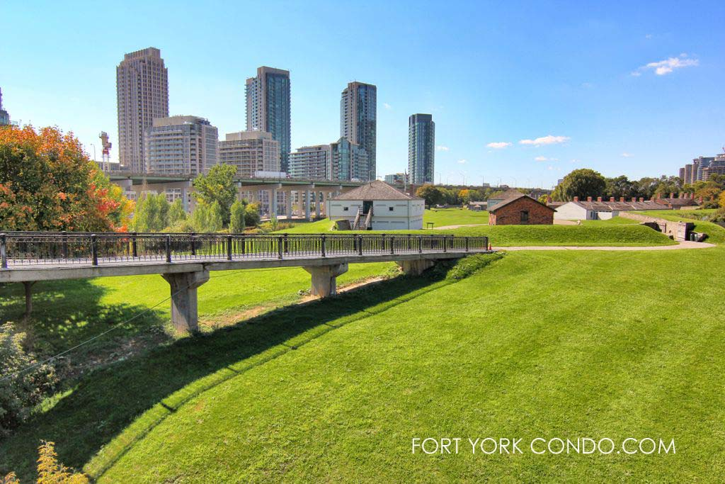 Green hills of historic Fort York in front of the Fort York Condos