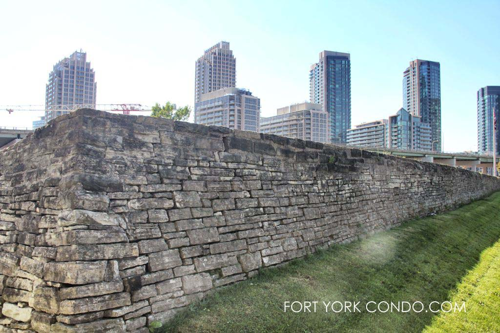 Stone Wall of historic Fort York in front of Fort York Condos