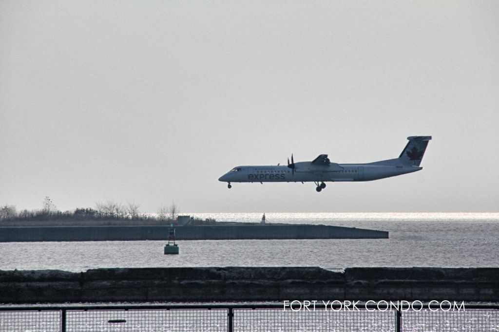 Air Canada Express landing at Toronto Island Airport near Liberty Village