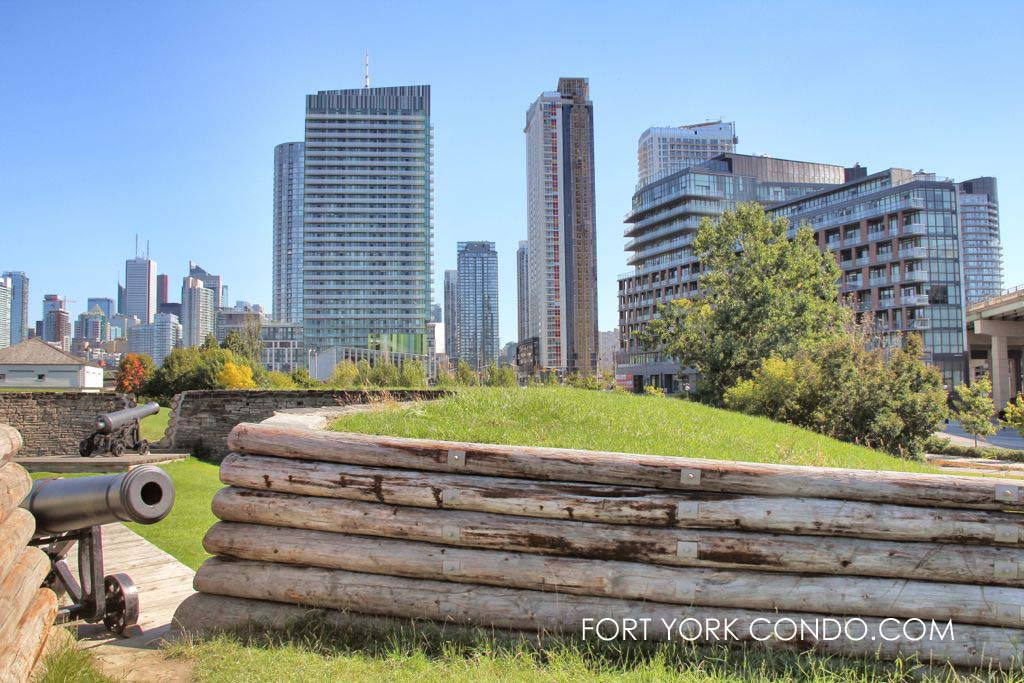 Fortifications and cannon at Fort York with condo buildings behind